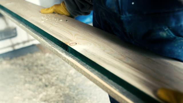 wood planing tight super slow motion - sawdust stock videos and b-roll footage