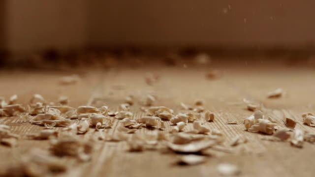 wood shavings falling on the floor. - wood material stock videos & royalty-free footage