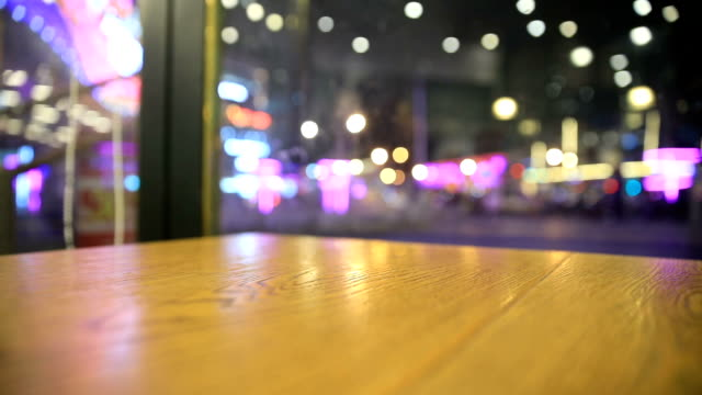 Wood table top with blurred light at night