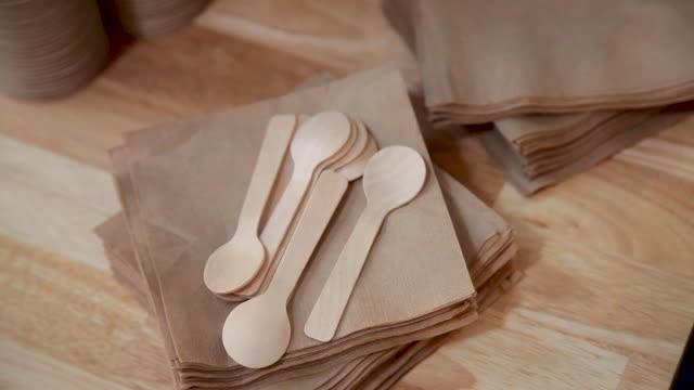 wood tasting spoons on napkins - napkin stock videos & royalty-free footage