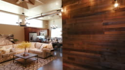 Wood Wall and Lights Panning and Lowering to Main Living Room Open Layout