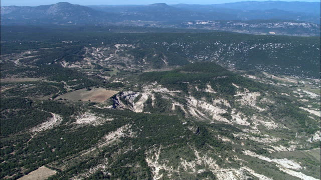 wooded escarpments to the east of ferrieres-les-verreries  - aerial view - languedoc-roussillon, gard, arrondissement du vigan, france - parc national stock videos & royalty-free footage