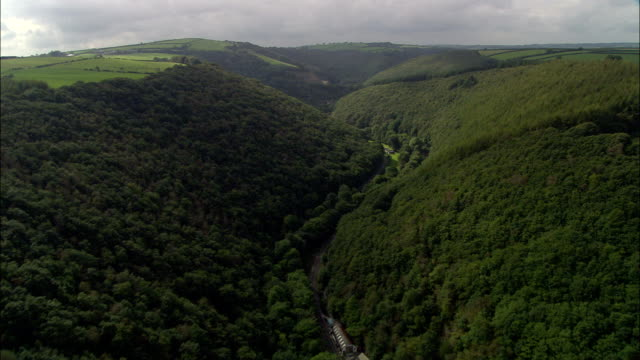 wooded valley at pentre morgan  - aerial view - wales, carmarthenshire, united kingdom - valley stock videos & royalty-free footage