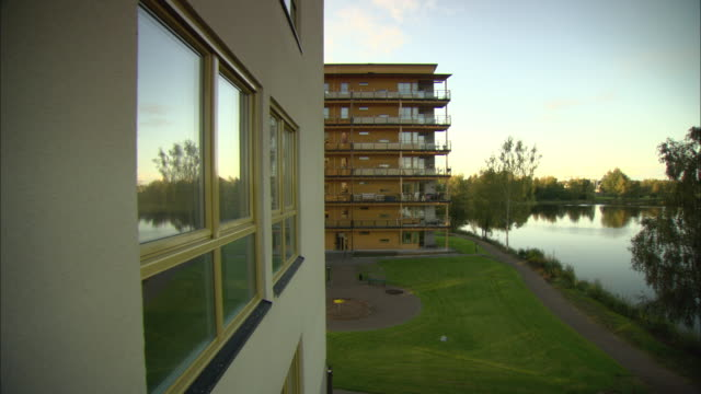 WS Wooden apartment building bordering lake / Vaxjo, Sweden