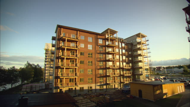 ws wooden apartment building under construction / vaxjo, sweden - housing development stock videos & royalty-free footage