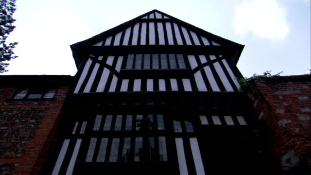 wooden boards trim the outside of a medieval house in lavenham, england. available in hd. - lavenham stock-videos und b-roll-filmmaterial