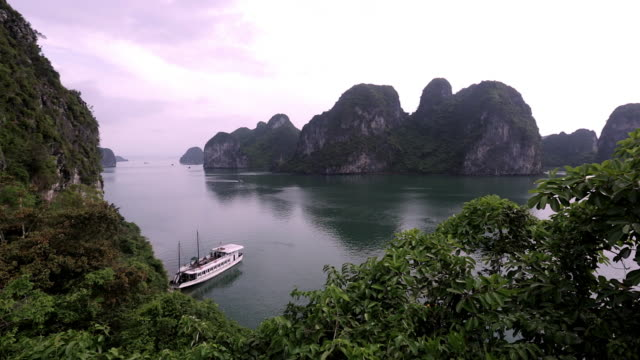 WS HA Wooden boat anchored in bay / Ha Long Bay, Vietnam