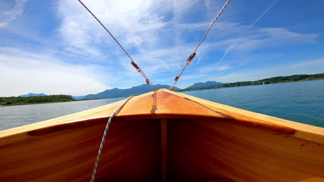 stockvideo's en b-roll-footage met wooden boat at lake chiemsee in summer - sunny