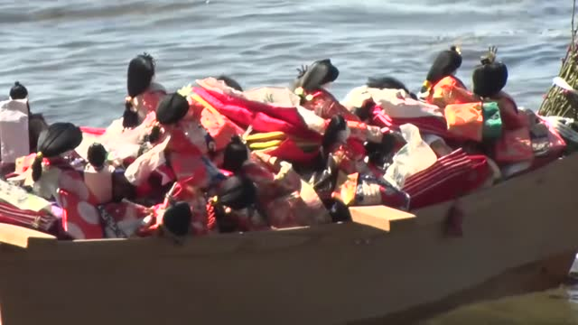 wooden boat loaded with hundreds of dolls from awashima shrine in wakayama sails in the sea off the western japan city on march 3 in a traditional... - shinto shrine stock videos & royalty-free footage