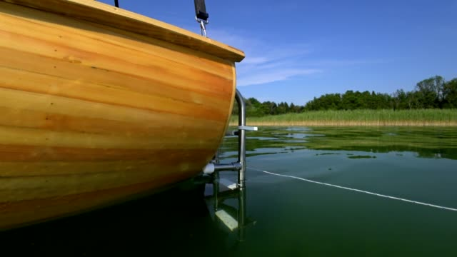 wooden boat on lake chiemsee in summer - wood grain stock videos & royalty-free footage