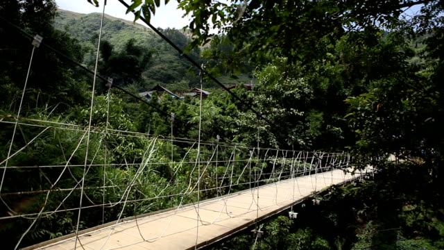 wooden bridge in tropical forest in sa pa, vietnam - sa pa stock videos and b-roll footage