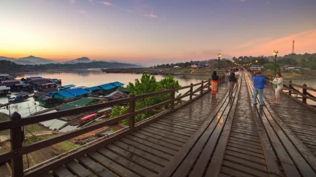 Wooden bridge over the river (Mon Bridge) at Sangklaburi District, Kanchanaburi, Thailand.