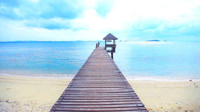 Wooden bridge that leads to the sea.