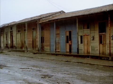 ms, wooden buildings along street, rainy day, nuevitas, cuba  - unknown gender stock videos & royalty-free footage