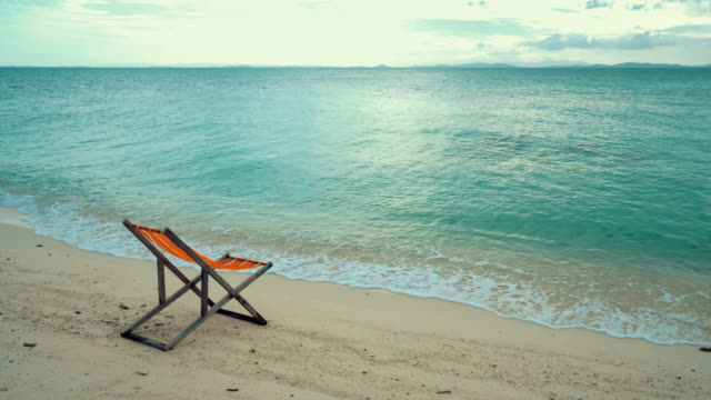 wooden comfortable chair on the beach clear sky and beautiful sea - sun lounger stock videos & royalty-free footage