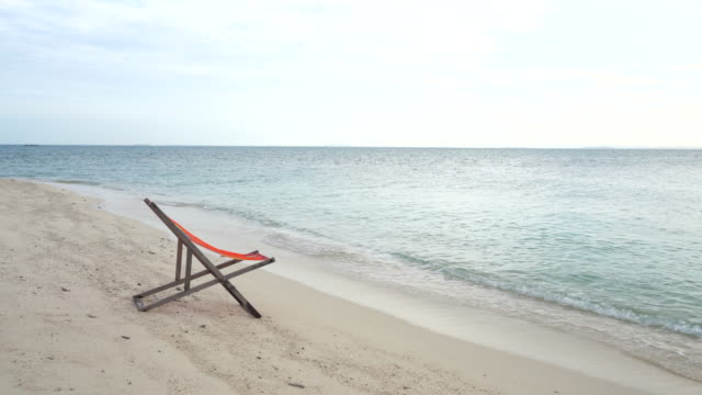 wooden comfortable chair on the beach clear sky and beautiful sea - outdoor chair stock videos & royalty-free footage