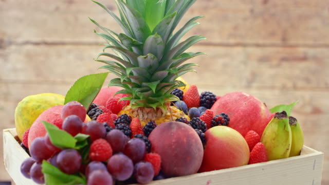 ld a wooden crate full of fresh fruits turning on the table - berry fruit stock videos & royalty-free footage