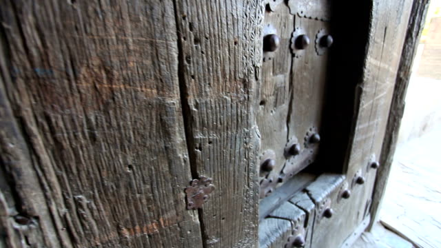 wooden doors ark fortress. forged products. - bukhara stock videos and b-roll footage