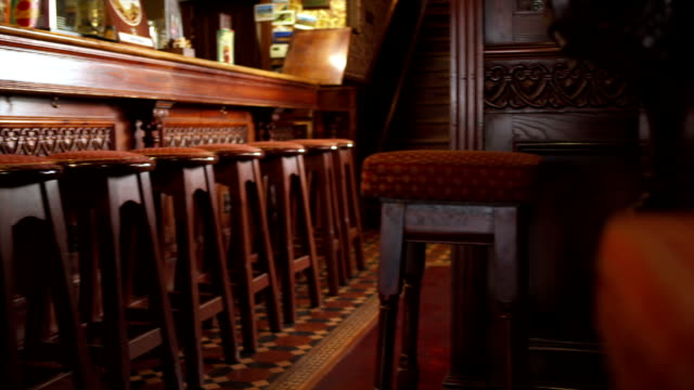 wooden furniture in the pub - english culture stock videos & royalty-free footage