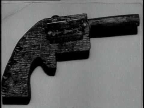 cu wooden gun used by dillinger in an escape / united states - john dillinger stock-videos und b-roll-filmmaterial