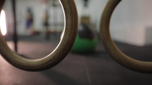 wooden gymnastic rings at gym - gymnastic rings stock videos & royalty-free footage