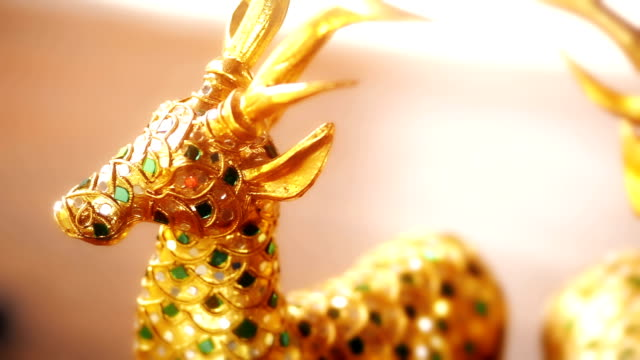 wooden hand carved deer statue with gold, wood home decoration figurines. - figurine stock videos and b-roll footage