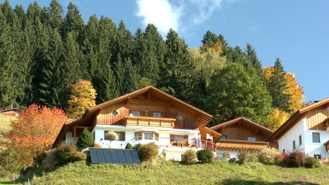 wooden houses with solar panels in autumn - deciduous tree stock videos & royalty-free footage