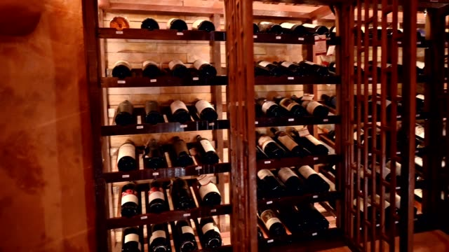 wooden interior of wide bottles in storage room - wine stock videos & royalty-free footage