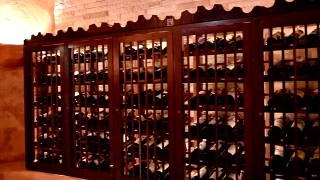 wooden interior of wide bottles in storage room - wine cellar stock videos and b-roll footage
