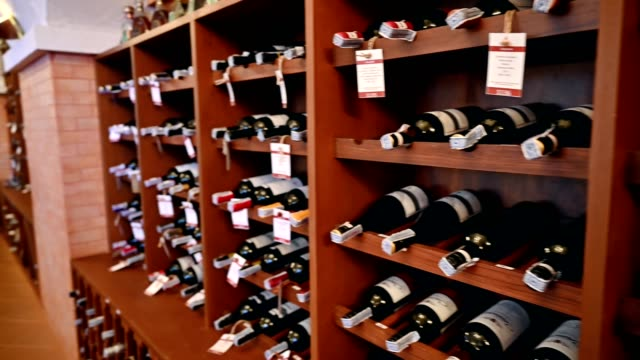 wooden interior of wide bottles in storage room - wine bottle stock videos & royalty-free footage