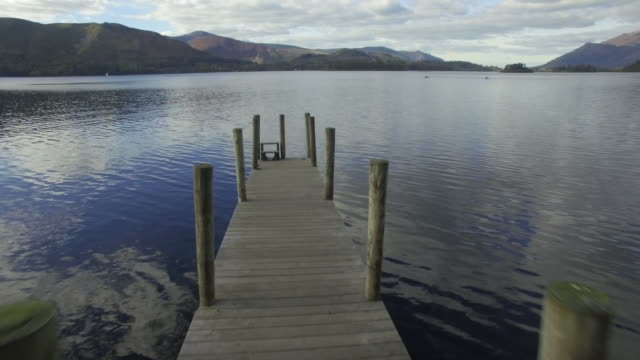Wooden jetty at Barrow Bay landing, Derwent Water, Lake District National Park, Cumbria, England, United Kingdom
