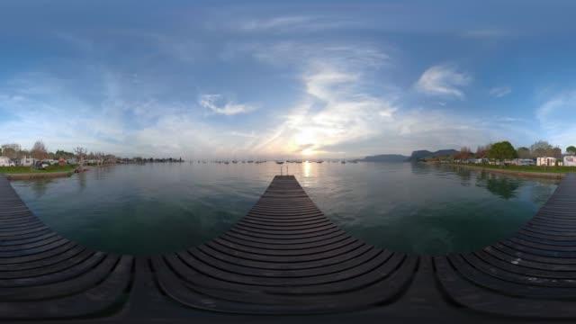 360 VR / Wooden jetty on Lake Garda at sunset