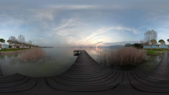 360 vr / wooden jetty on lake garda at sunset - pinaceae stock videos & royalty-free footage