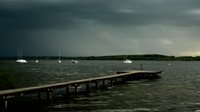 wooden jetty on lake with thunderstorm and lightning, inning stegen, fuenfseenland, upper bavaria, bavaria, germany - inning stock videos & royalty-free footage