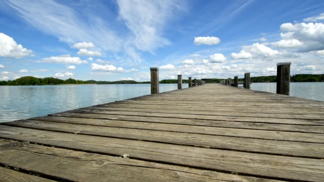 wooden jetty on lake worthsee, fuenfseenland, upper bavaria, bavaria, germany - jetty stock videos & royalty-free footage