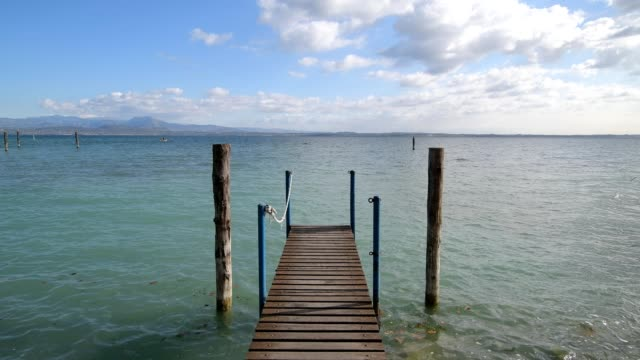 wooden jetty on the lake, sirmione, brescia, lake garda, lago di garda, lombardy, lombardei, italy - lago stock videos & royalty-free footage
