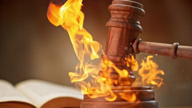 slo mo ld wooden judge's gavel striking a burning sound block - gavel stock videos and b-roll footage