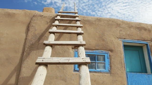 ds wooden ladder leaning against adobe building, taos pueblo, new mexico, usa - wood material stock videos & royalty-free footage