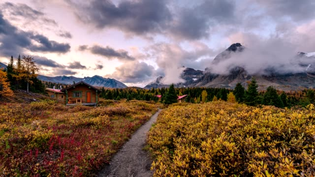 wooden naiset huts with rocky mountains in assiniboine provincial park at morning - cabin stock videos & royalty-free footage