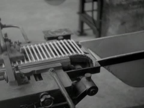 Wooden pencils move along conveyer belts in a pencil factory
