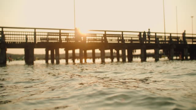 wooden pier during sunset over the lake - pier stock videos & royalty-free footage