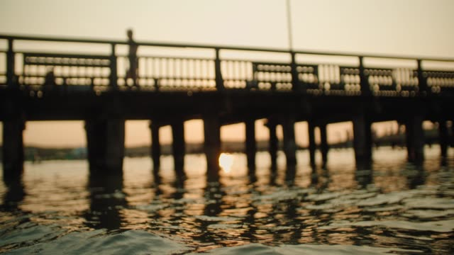 wooden pier during sunset over the lake - jetty stock videos & royalty-free footage