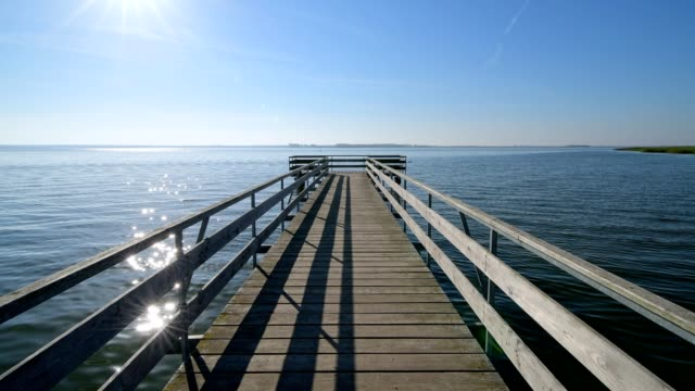 Wooden pier with sun, Seebrücke Born, Born am Darß, Fischland-Darß-Zingst, Baltic sea, Mecklenburg-Vorpommern, Germany