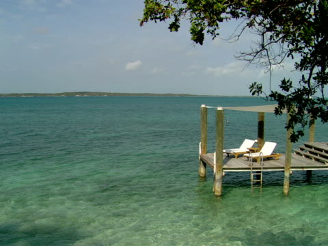 ws,  wooden pier with two lounge chairs,  harbour island,  bahamas - stationary process plate stock videos & royalty-free footage