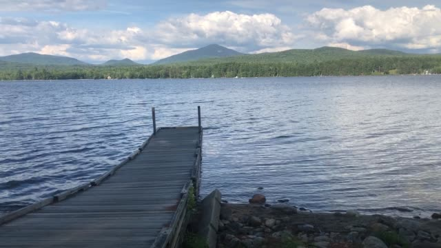 wooden plank pier at weld pond in mt blue state near weld, maine usa - named wilderness area stock videos & royalty-free footage