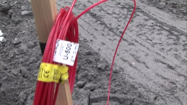 wooden posts marked with red or blue signify the type of wire being lowered into a mine shaft. - mine shaft stock videos & royalty-free footage