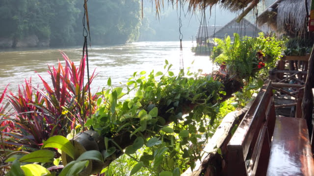 wooden raft resort in tropical rainforest on river kwai at kanchanaburi - cruise collection stock videos & royalty-free footage