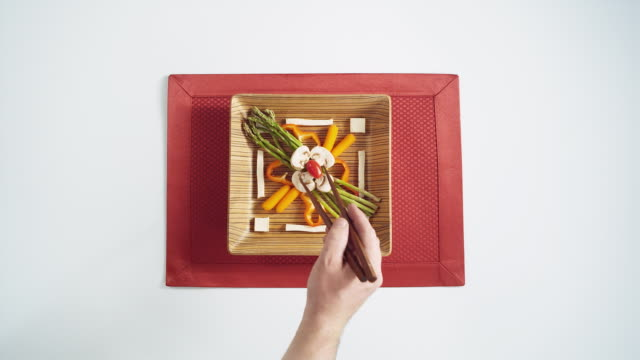 MS HA Wooden square plate with vegetables and tofu artfully arranged on red napkin