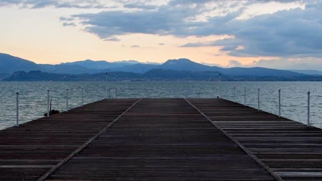 wooden sunbathing platform on the lake, sirmione, brescia, lake garda, lago di garda, lombardy, lombardei, italy - lago stock videos & royalty-free footage
