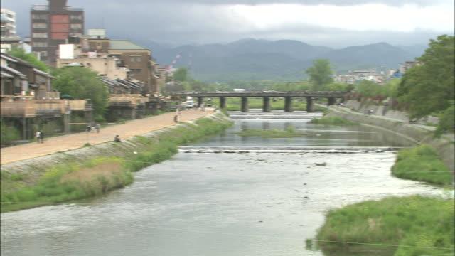 Wooden terraces overlook the Kamo River in Kyoto, Japan.